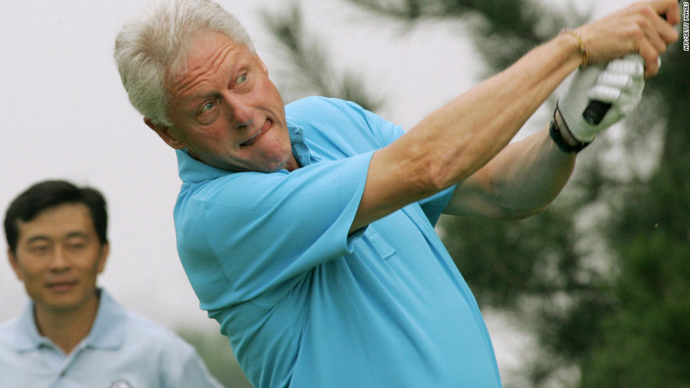 Former President Bill Clinton tees off at the first hole during a World Celebrity Golf event in Beijing in 2005.