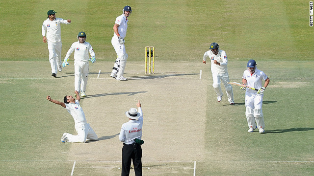 Abdur Rehman of Pakistan celebrates dismissing England's Kevin Pietersen during the second Test match in Abu Dhabi