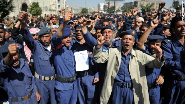 Yemeni air force personnel demand the removal of the president's half-brother as air force  chief in a rally Saturday in Sanaa.