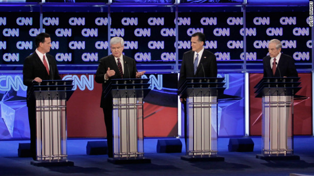 JACKSONVILLE, FL - JANUARY 26: Republican presidential candidates (L-R) former U.S. Sen. Rick Santorum, former Speaker of the House Newt Gingrich (R-GA), former Massachusetts Gov. Mitt Romney and U.S. Rep. Ron Paul (R-TX) participate in a debate moderated by CNN's Wolf Blitzer (R) at the University North Florida on January 26, 2012 in Jacksonville, Florida. The debate is the last one before the Florida primaries January 31st. (Photo by Joe Raedle/Getty Images)