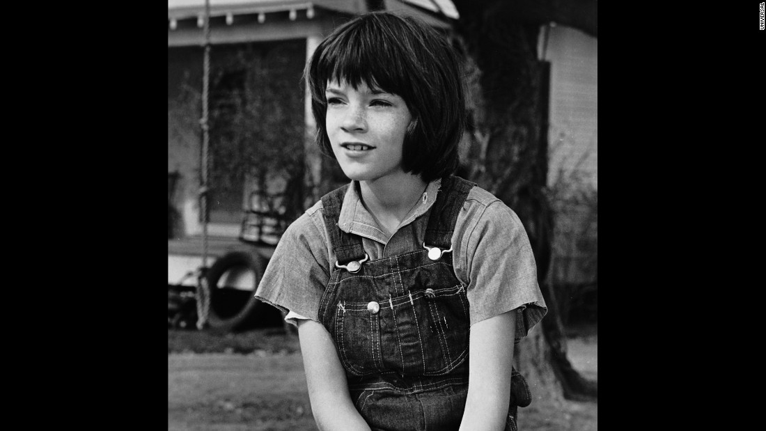 Mary Badham as Scout Finch.