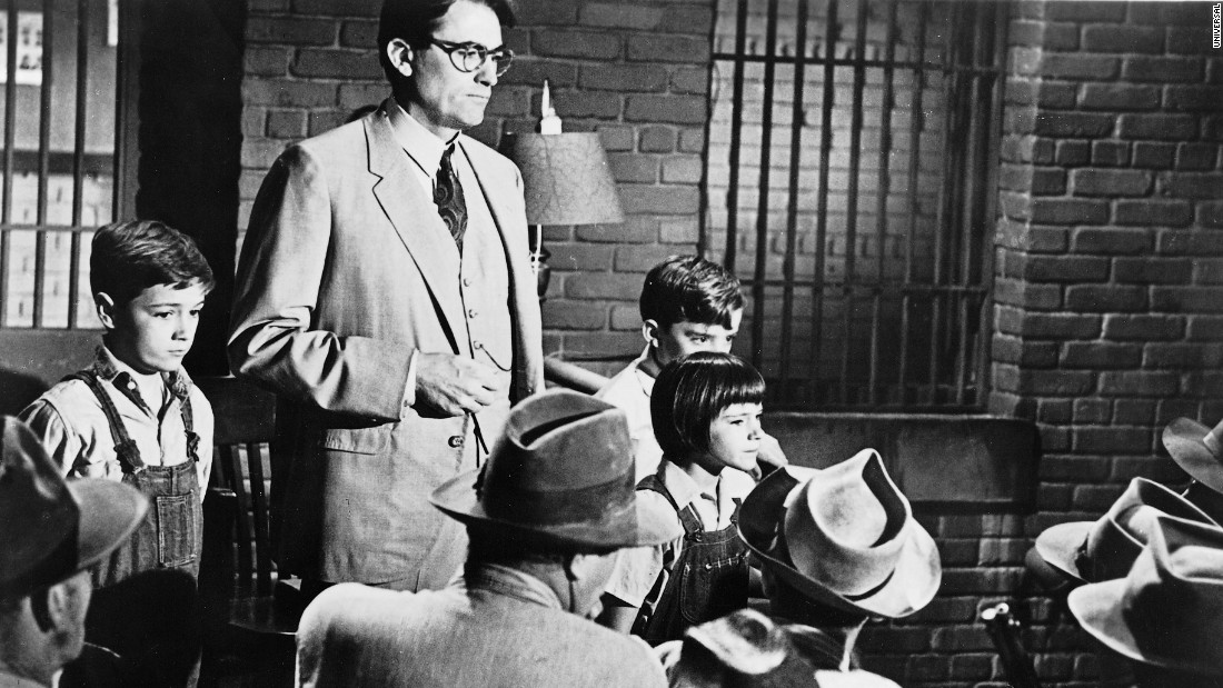 The children, having followed Atticus to the jail, help turn away an angry crowd.