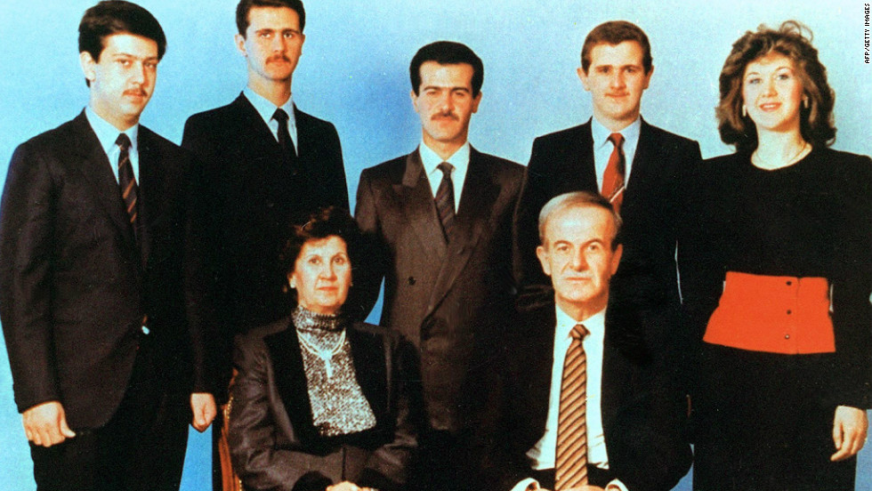 Undated picture shows Syrian President Hafez Assad and his wife Anisseh posing for a family picture with his children Maher, Bashar, Basil, who died in a car accident in 1994, Majd and Bushra.