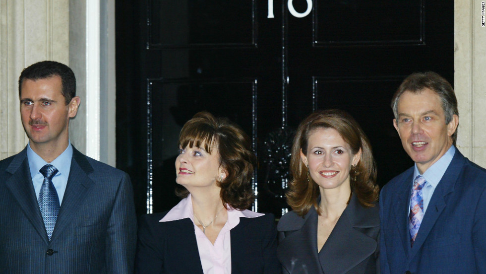 Syrian President Bashar Al-Assad and his wife Asma (third left, pose for photographers with Britain's Prime Minister Tony Blair and his wife Cherie outside No. 10 Downing Street in London on December 16, 2002.