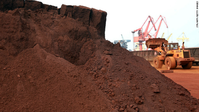 In a picture taken on September 5, 2010 a man driving a front loader shifts soil containing rare earth minerals to be loaded at a port in Lianyungang, east China's Jiangsu province, for export .