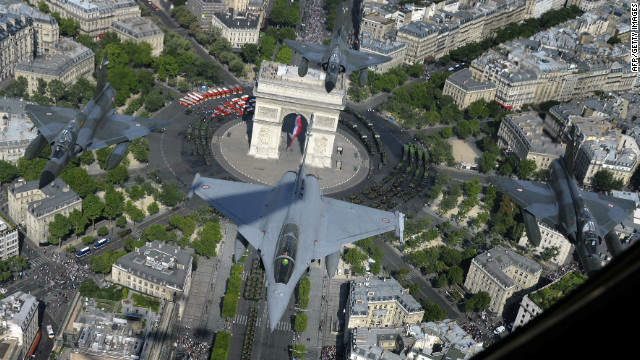 A French Rafale jet flies over the Paris Arc de Triomphe accompanied by three Mirage 2000-N on July 14, 2011 during the Bastille Day military parade.