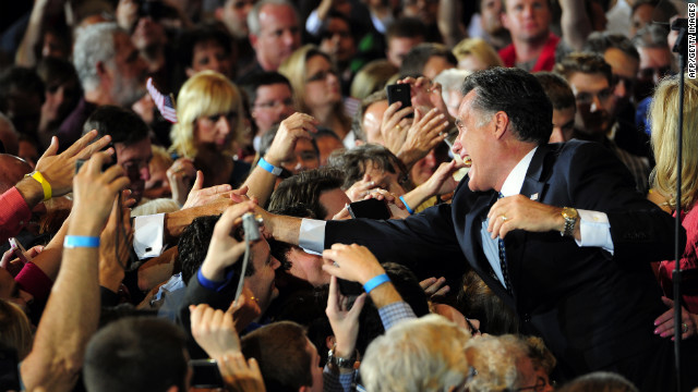 GOP presidential hopeful Mitt Romney celebrates during a primary election night rally in Tampa, Florida.