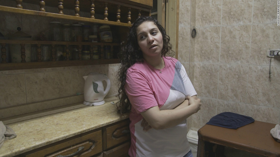 University student Lamiz Ragib, 21, says she was arrested together with her husband by plain clothes police, sexually harassed, and bullied to testify against her husband, who was detained on a trumped up drugs and possessions of weapons charge. Lamiz succeeds in getting her husband released with the help of a Cairo Human Rights Center.