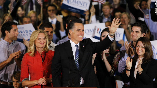 Republican presidential candidate Mitt Romney waves to supporters as his wife, Ann, looks on during his Florida primary night party on Tuesday in Tampa, Florida.
