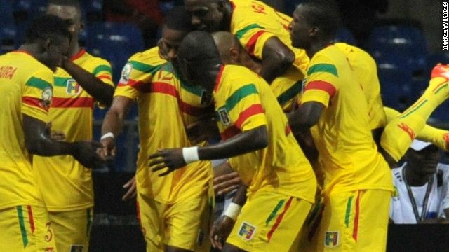 Mali players surround Seydou Keita after he scores the winning goal in their 2-1 victory over Botswana.