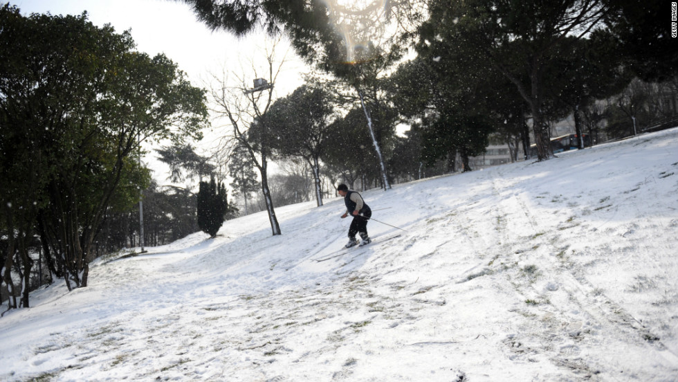 A skier takes advantage of the unusual snowfall in Istanbul, Turkey, on Tuesday. The snow paralyzed daily life there.