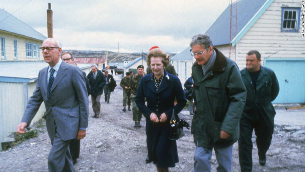 British Prime Minister Margaret Thatcher and her husband Denis, left,  visit Stanley Junior School, Stanley on the Falkland Islands in 1983.