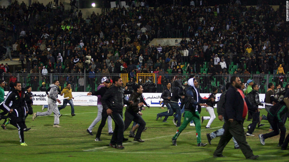 Egyptian football fans rush on to the field during the clashes.
