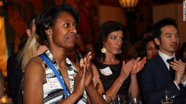 "Army veteran Tracey Cooper-Harris, left, attends a ""Heroes Celebration"" last April in Los Angeles."