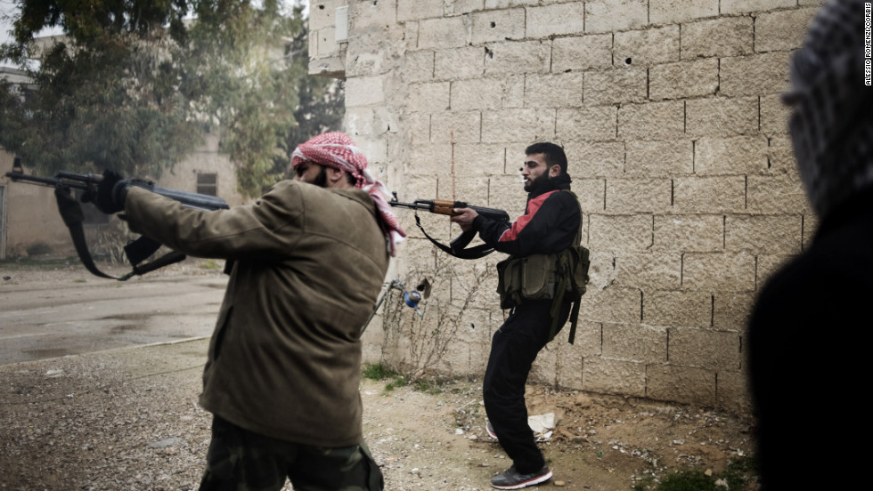 Opposition fighters fire on Syrian soldiers on January 24. Syria has seen a sharp increase in violence in recent weeks, with hundreds killed in clashes between government forces, rebels and protesters.