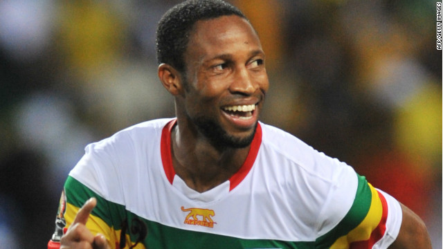 Seydou Keita celebrates converting the winning penalty as Mali reached the Africa Cup of Nations semifinals.