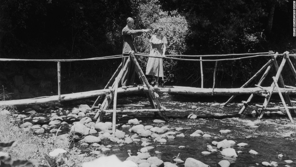 5th February 1952: Princess Elizabeth and the Duke of Edinburgh admiring the view from a bridge in the grounds of Sagana Lodge, their wedding present from the people of Kenya.