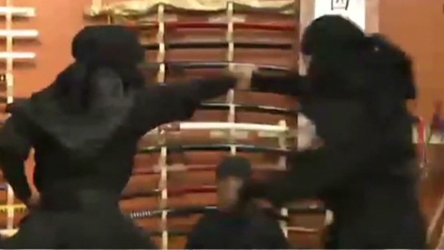 A Reuters video showed women clad head to toe in black, running up walls, flipping backwards, diving and rolling over swords.