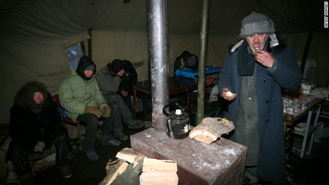 Homeless people seek shelter from the cold, in the Ukrainian city of Donetsk, on February 6, 2012.