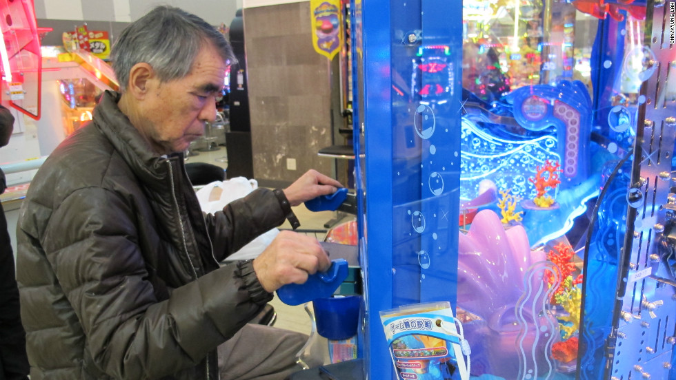 Teruo Kataoka plays a video game at the Sega Game Center in Yokohama, Japan.