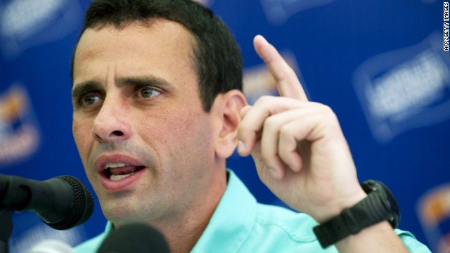 Venezuelan candidate of the opposition Democratic Unity coalition for the upcoming primary elections, Henrique Capriles Radonski, delivers a speech during press conference in Caracas on February 7, 2012.
