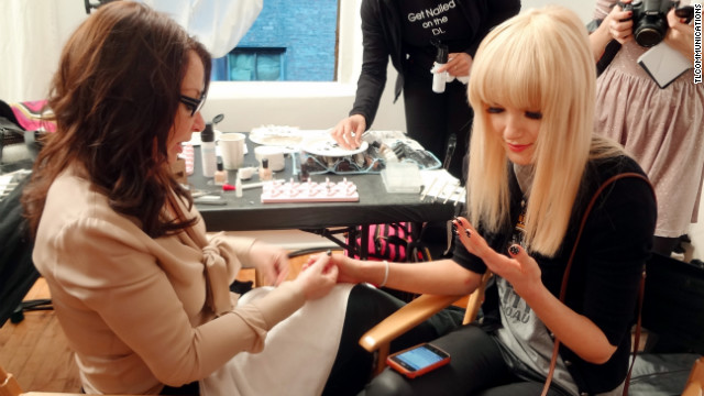 Celebrity nail tech Deborah Lippmann works with a model for Kate Spade at Fashion Week in New York.