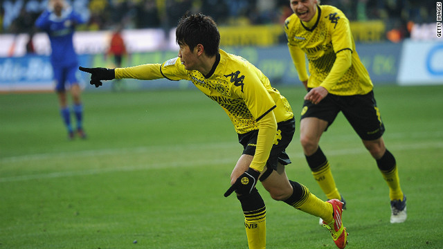 Borussia Dortmund's Shinji Kagawa celebrates scoring the winning goal against Bayer Leverkusen on Saturday.