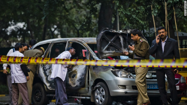 Police and forensic officers examine a damaged Israeli embassy vehicle after an explosion on February 13 in New Delhi, India.