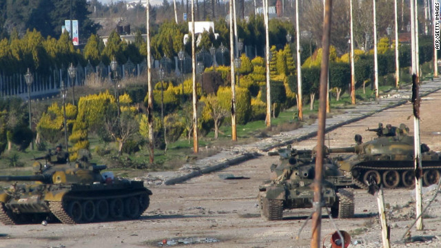 Syrian Army tanks are stationed at the entrance to the Baba Amr neighbourhood in Homs on Monday.