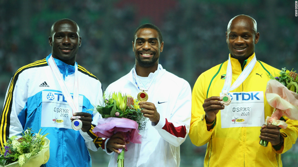 Gay on the podium collecting the gold medal for winning the 100m at the 2007 World Athletics Championships in Osaka, Japan. He also won the 200m from Bolt and picked up another title in the 4x100m relay.