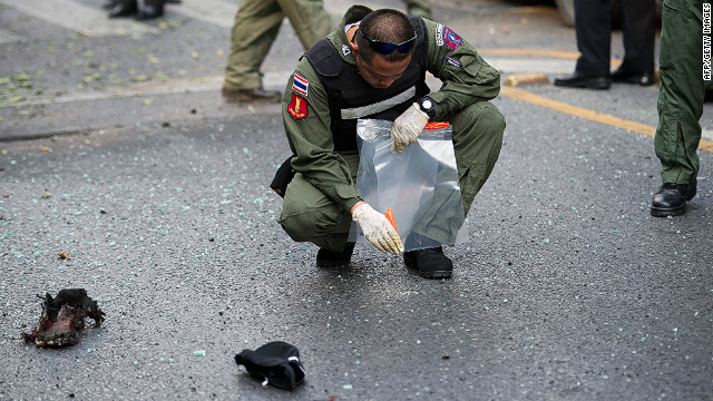 Thai bomb squad officials inspect the site of an explosion in Bangkok on February 14, 2012.