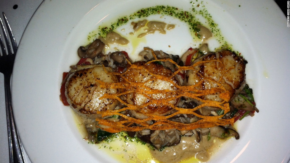 """The jumbo sea scallops at Commander's Palace are to die for!"" wrote iReporter Sonia Garza of Pasadena, Texas."