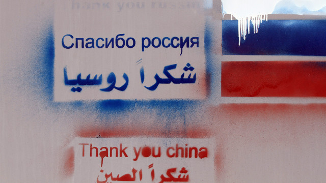 "Graffitti reading ""Thank you, Russia"" and ""Thank you, China"" on the wall of the Russian Embassy in Damascus, February 15."