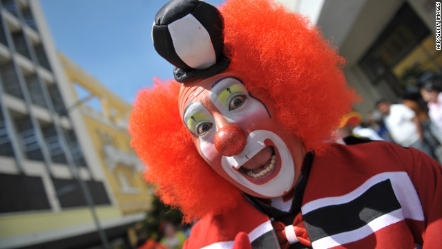 A clown poses for the camera during a parade for the III Latin American Clown Congress on July 26, 2011.