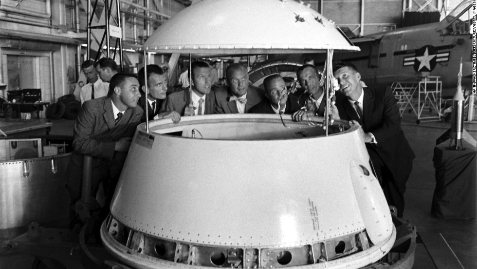 "The original Mercury 7 astronauts inspect an early design of a space module. From left are Gus Grissom, Deke Slayton, Gordon Cooper, John Glenn, Scott Carpenter, Alan Shepard and Wally Schirra. In 1962, Glenn was the first American to orbit the Earth. <a href=""http://life.time.com/history/john-glenn-unpublished-photos/#1"" target=""_blank"">See more images at Life.com</a>"