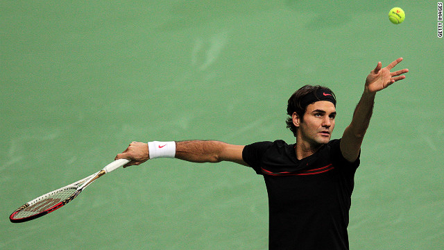 Roger Federer serving during his semifinal meeting with Russia's Nikolay Davydenko in Rotterdam on Saturday