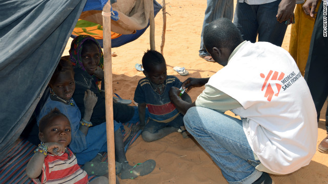 A MSF (Doctors Without Borders) worker checks on malnourished childern on February 4, 2012 at a refugee camp in Chinegodar, western Niger
