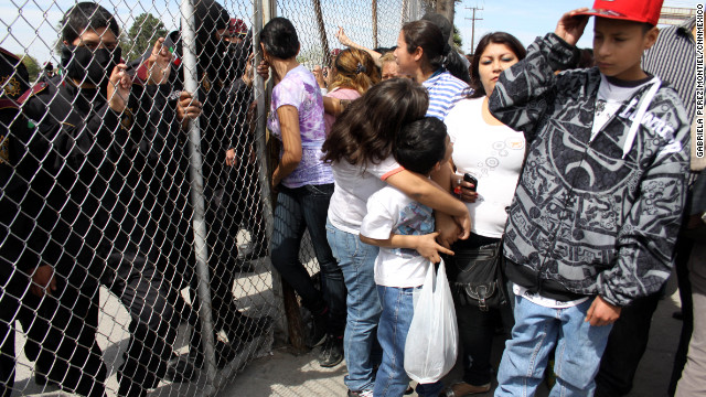 People gather outside a prison in northern Mexico to find out if their family members were killed in a riot on Sunday, February 19.