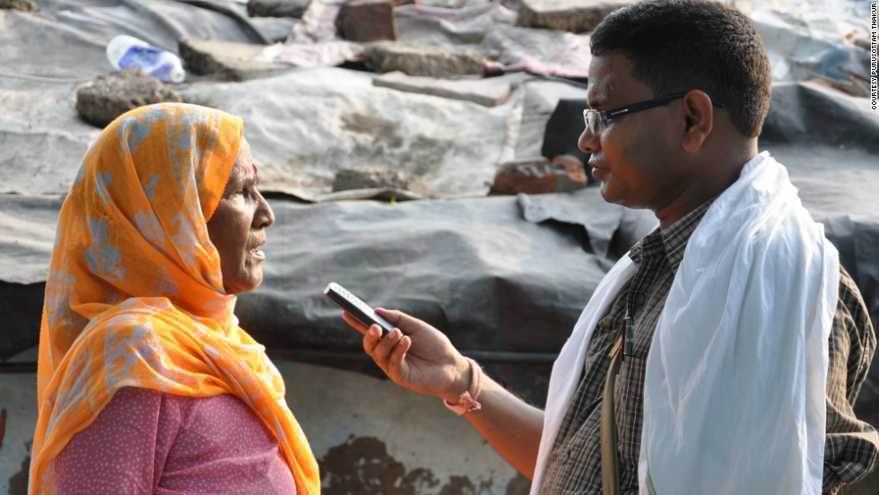A woman is interviewed by a citizen journalist for for CGNet Swara, a voice portal that allows rural Indians to dial-in via their mobile phones and listen to local news reports for areas where there is often little media coverage.