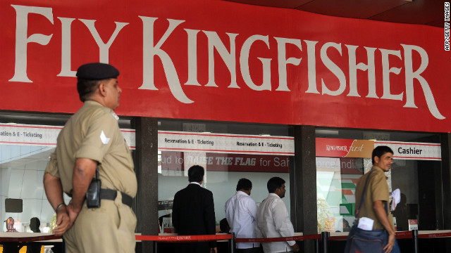 A security staffer stands near the Kingfisher Airlines booking counter at the domestic terminal in Mumbai on February 21, 2012.