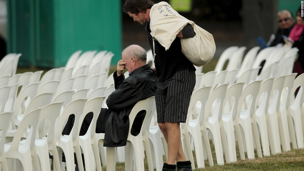 A man waits for a memorial service at Latimer Square to begin as Christchurch marks one year since last February's devastating earthquake.