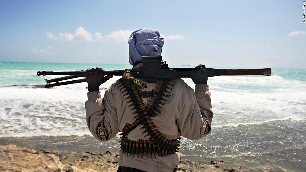 Heavily armed pirates have taken advantage of the nation's lawless coastal waters to become a major threat to international shipping in the area. In this photo, a gun-wielding pirate keeps vigil along the coastline at Hobyo town, north-eastern Somalia, 2009.