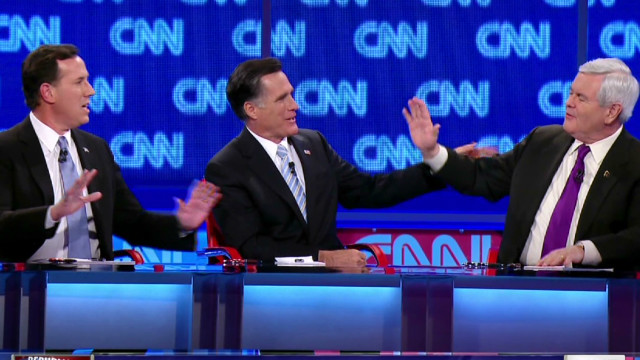 Santorum, Romney clash on earmarks