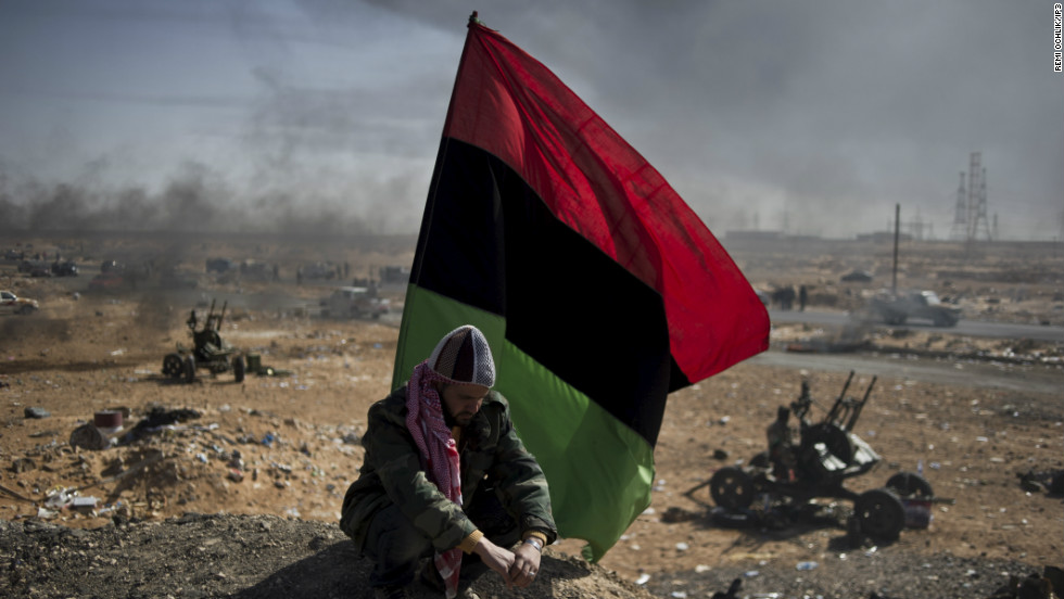 He won first prize in the World Press Photo competition's news category for this image of a Libyan opposition fighter resting under a rebellion flag in the middle of Ras Lanouf.