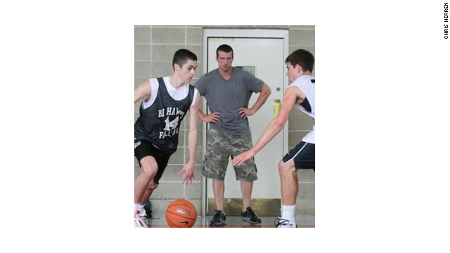 Chris Herren, center, launched a basketball clinic for kids the year after he got clean.