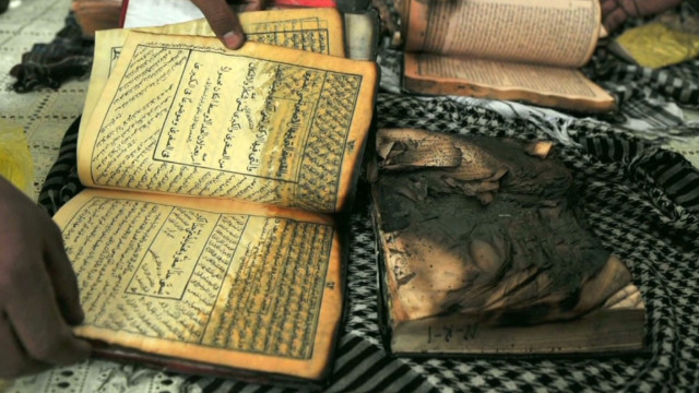 tsr.pkg.lawrence.quran.burning_00004815