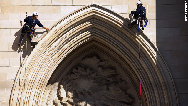 Katie Francis, left, and Emma Cardini, look for damage on the National Cathedral in Washington last October after an earthquake.