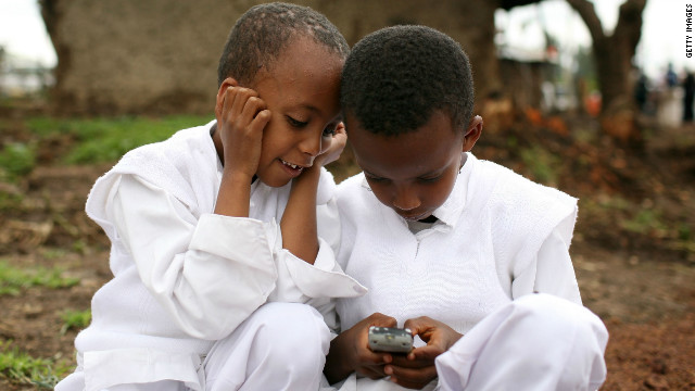 Two boys play with a cellular phone in Ethiopia. Figures show that mobile penetration in Africa is at an all time high.