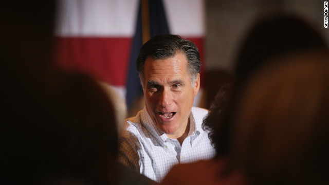 Former Massachusetts Gov. Mitt Romney greets guests before a tea party event Thursday in Milford, Michigan.
