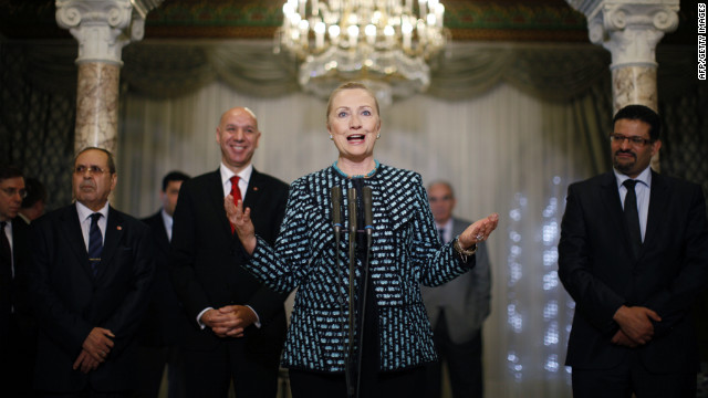 U.S. Secretary of State Hillary Clinton speaks to the press Saturday alongside members of Tunisia's government.